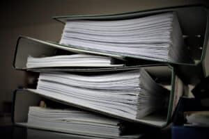 a stack of notebooks that may be provided in response to requests for production